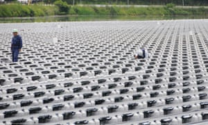 Engineers at work at a floating solar power plant in Hyogo Prefecture, western Japan.