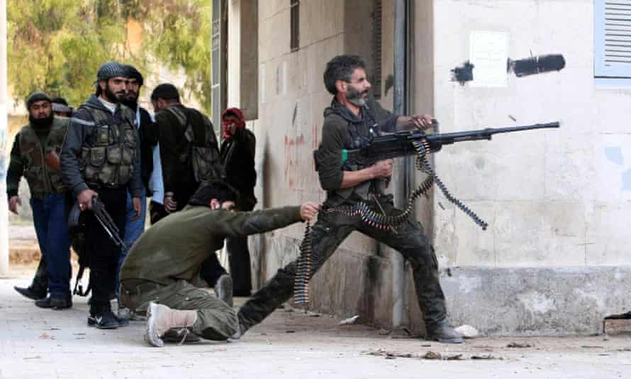 A Free Syrian Army fighter fires his weapon during clashes in Aleppo. The Old Bailey was told by the crown that there was no longer a reasonable prospect of a prosecution.
