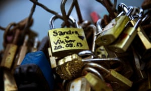 A close-up view of 'love locks' attached to a fence on the Pont des Arts in Paris