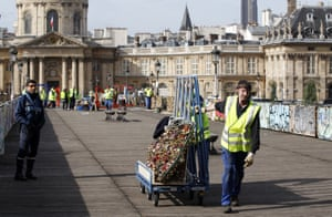 A city municipal employe removes the barriers with love padlocks on the Pont des Arts