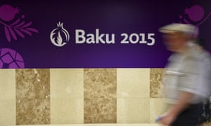 A man passes a banner promoting the 2015 European Games in Baku.