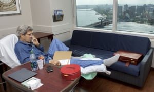 John Kerry on the phone from his bed in Massachusetts General hospital, Boston, where he is recovering from surgery on his broken leg.