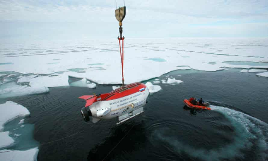 A Russian deep-diving miniature submarine is lowered from the research vessel Akademik Fyodorov moments before performing a dive in the Arctic Ocean beneath the ice at the North Pole in 2007.
