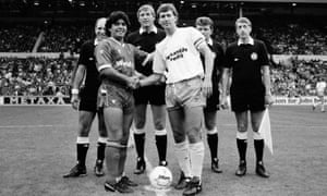 World XI captain Diego Maradona, left, meets Football League XI skipper Bryan Robson before their Football League Centenary match at Wembley on 8 August 1987.