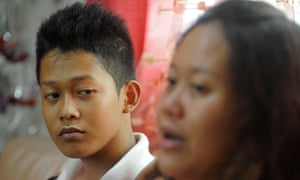 Reynaldo Nilo, 17, looking on with his sister Sarah Joy Nilo at a relative's home in Manila.