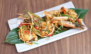 'Big tiger prawns under a deep leaf fall of fresh green herbs and crushed peanuts.'