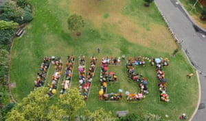 The Human Banner (Melbourne) 350.org activists during Global divestment day in Australia on February 14, 2015