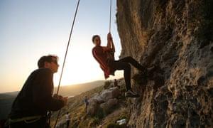 A group of Palestinians climb