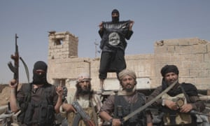 Islamic State fighters on the border between Syria and Iraq