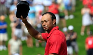 A solemn Tiger Woods acknowledges the crowd on the 18th hole during the final round of The Memorial Tournament.