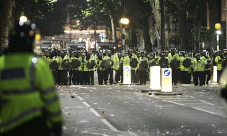 Police are seen in Ladbroke Grove, London, as trouble breaks out during the Notting Hill Carnival