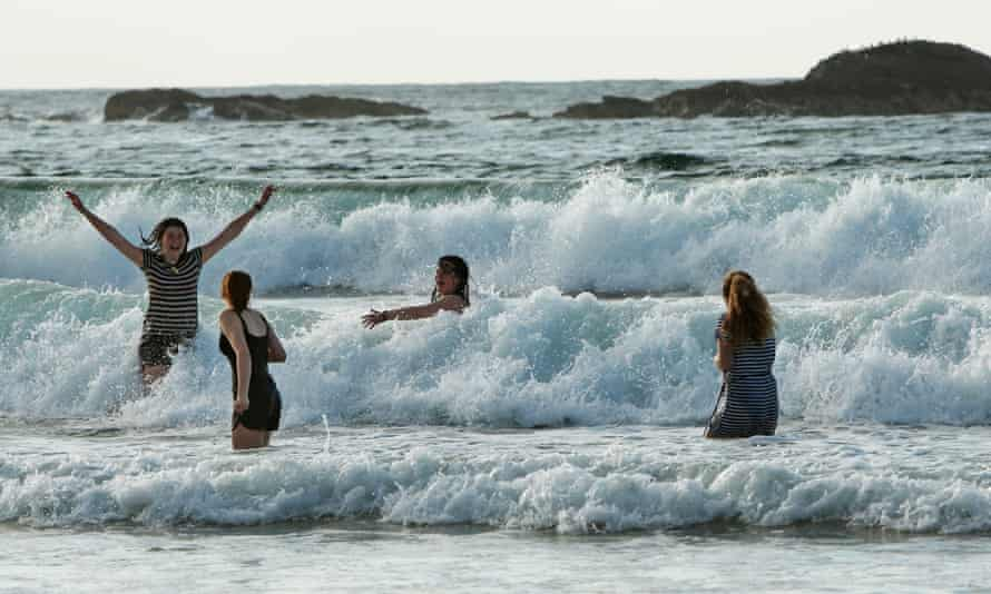Ride the wave: playing in the surf during the school trip to the Hebridean Island of Colonsay.