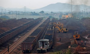 Freight trains are loaded with iron ore at a railway station at Chitradurga in southern Indian state of Karnataka