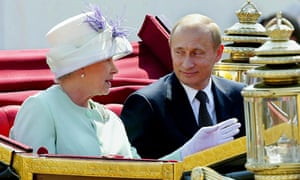 Vladimir Putin and Queen Elizabeth in an open carriage in London in 2003.