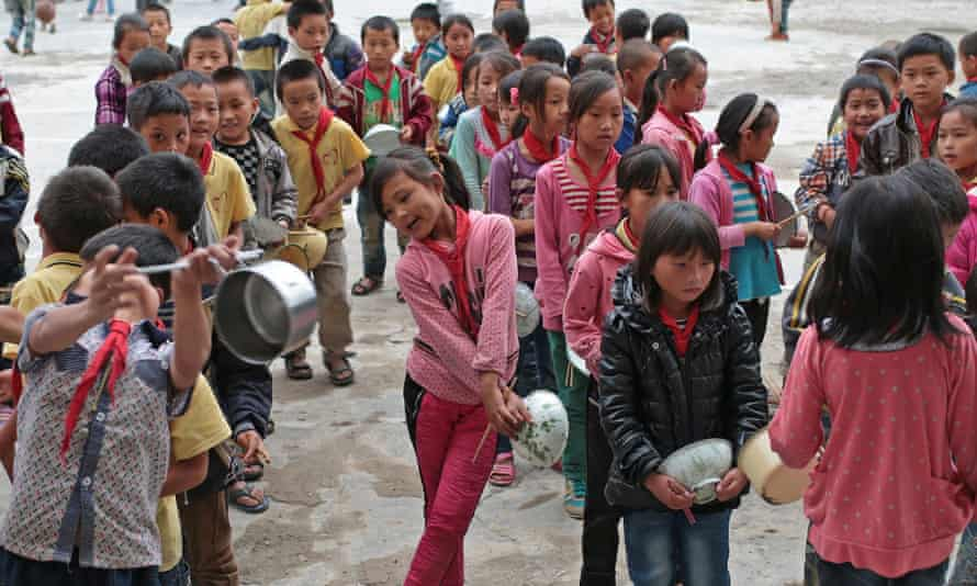 Left-behind children wait for lunch in a primary school of Maguang County, southwest China's Yunnan Province.