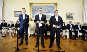 Centre, new Finnish Prime Minister Juha Sipila, with governmental coalition partners – foreign minister Timo Soini (right), chairman of Finns party, and finance minister Alexander Stubb (left), chairman of the National Coalition party.