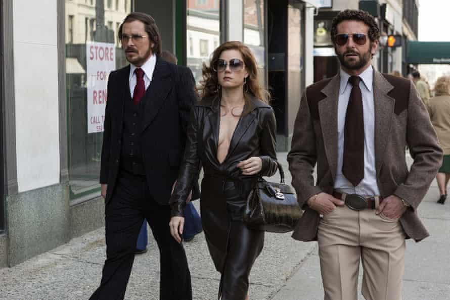 Christian Bale, Amy Adams and Bradley Cooper in American Hustle.