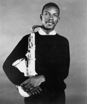 Jazz saxophonist Ornette Coleman poses for a portrait holding his saxophone in circa 1959.