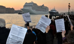 People take part in a demonstration against the negative environmental impact of cruise ships passing and mooring in the lagoon of Venice in 2012