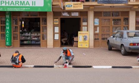 Painting the curbs of Kigali, Rwanda.