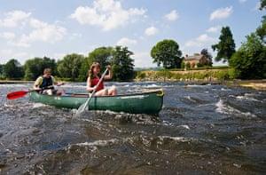 Canoeists paddling down the Wye.