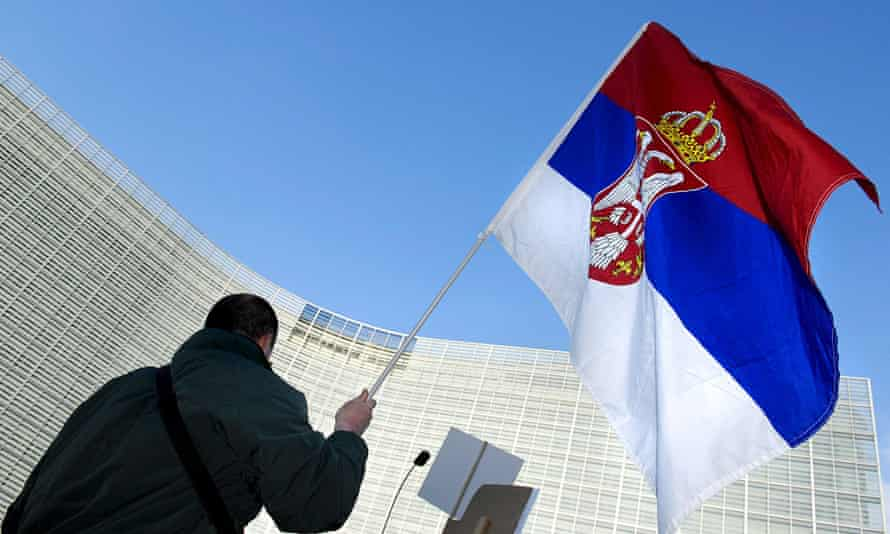 The Serbian flag waved outside European Union headquarters in Brussels.