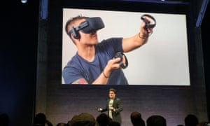 Oculus founder Palmer Luckey shows off the Oculus Rift's Touch controllers.