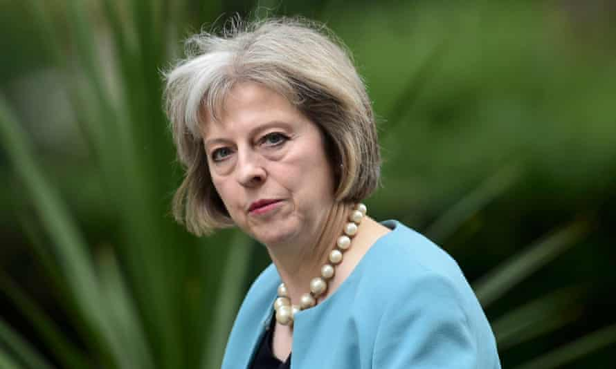 Home Secretary Theresa May arrives for a cabinet meeting at Number 10 Downing Street. A report by David Anderson QC describes legislation covering surveillance as 'fragmented', and urges the government to wipe the slate clean with a new bill.