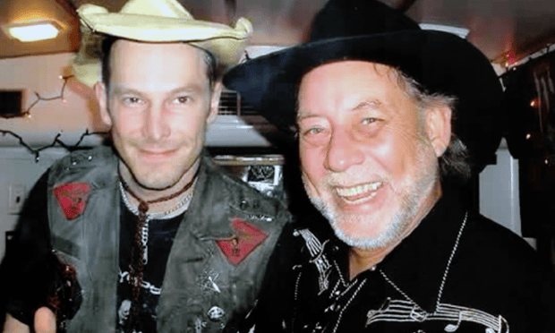 Randy Howard, right, poses with the country music star Hank Williams III.
