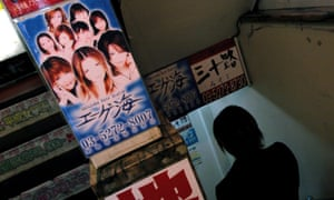 A man enters a strip club in central Tokyo.