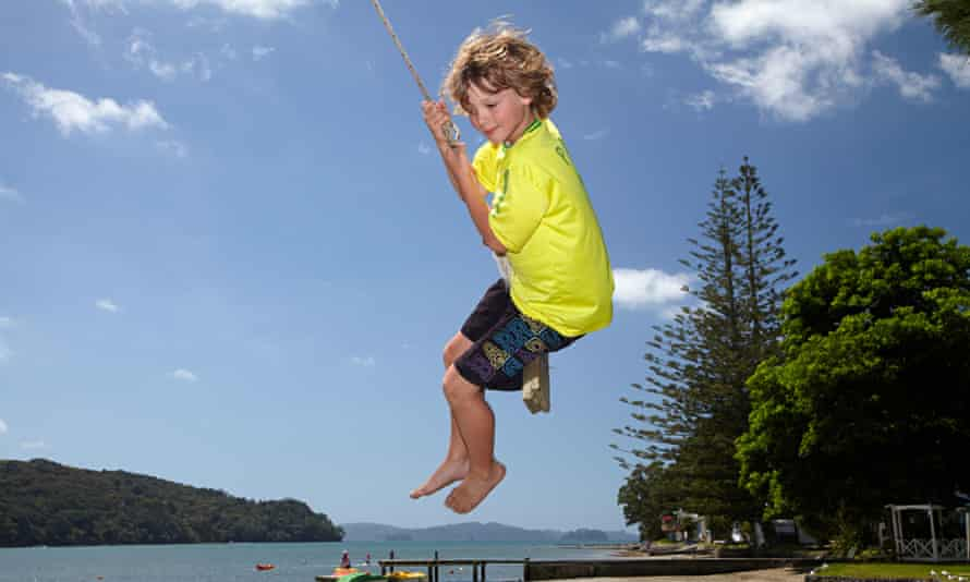 Young boy on rope swing