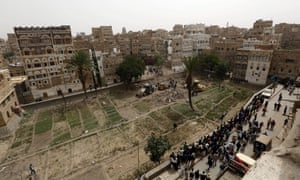 Yemenis inspect old buildings reportedly destroyed by an air strike carried out by the Saudi-led coalition
