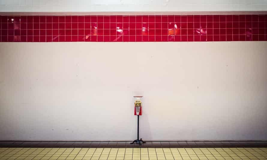Signal Hill mall: a lone candy machine, half-filled with M and M's, sits against a wall.