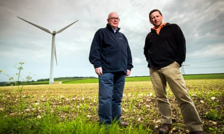 Bob Carnell (left) and John Zamik with a wind turbine in a field near Hinton, just outside Bristol.