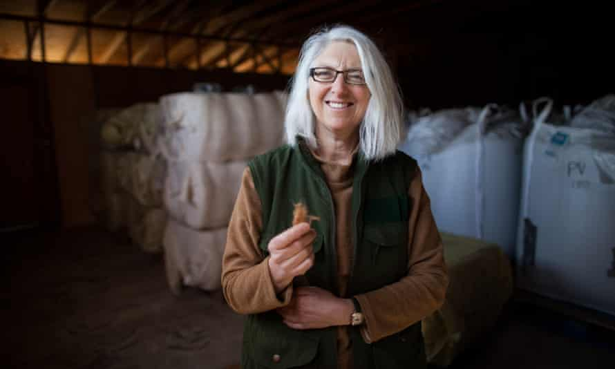 Organic cotton farmer Sally Fox holds a bit of her brown, shorter-fiber material used in The North Face's limited-edition hoodie.