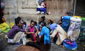Migrants from Eritrea wait for food at Milan train station on 11 June while the Italian authorities arrange accommodation.