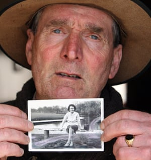 Irish writer John Pascal Rodgers, born in the home for unmarried mothers, poses with a photograph of his mother Bridie Rodgers, last year. Up to 800 babies and children were buried near the home run by nuns AFP PHOTO/PAUL FAITHPAUL FAITH/AFP/Getty Images