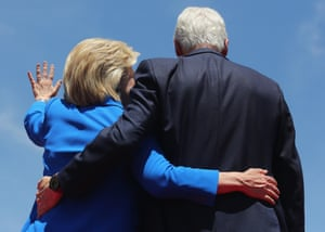 Hillary and Bill embrace.