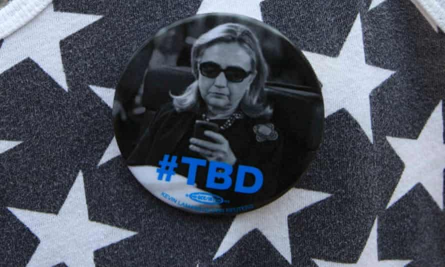 """A supporter wears a campaign button before U.S. Democratic presidential candidate Hillary Clinton delivers her """"official launch speech""""."""