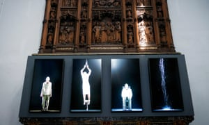 Bill Viola's video installation is shown front of a the carved 19th-century oak reredos in Auckland Caste, County Durham.