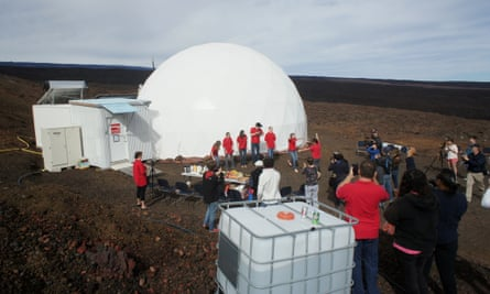 Six scientists exit the dome on the slopes of dormant volcano Mauna Loa, Hawaii, on Saturday.