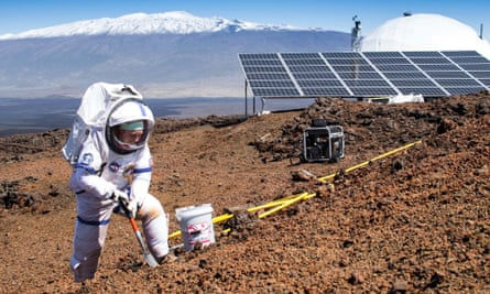 Mission commander Martha Lenio collects a sample of Hawaii soil during the study.