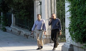 The Greek prime minister, Alexis Tsipras, left, and finance minister, Yanis Varoufakis, take a walk in central Athens.