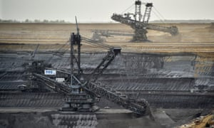 Giant machines dig for brown coal at an open-cast mine in Germany.