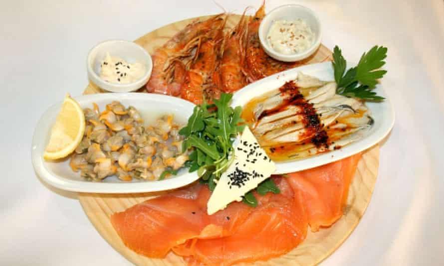 Seafood dish at El Jardi restaurant in the courtyard of the Hospital de la Santa Creu i Sant Pau, in Raval, Barcelona