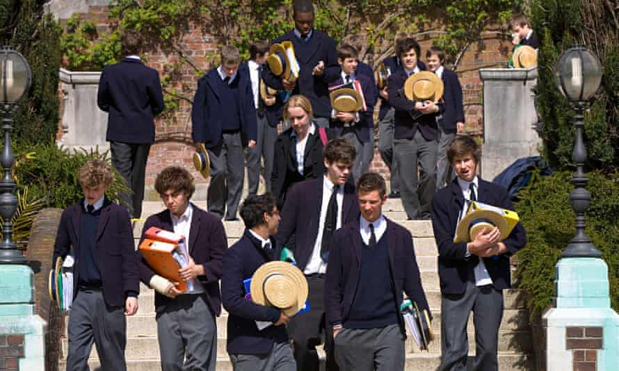 Schoolboys after lessons on the steps of Old School building Harrow School Harrow on the Hill