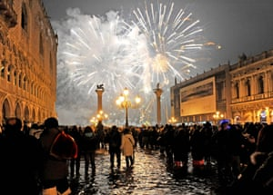 January 2010: People watch New Year's Eve fireworks over a flooded Piazza San Marco. When 'very intense' flooding conditions are reached, a siren will sound to alert people in the city. High-tide lasts an average of two and a half hours.