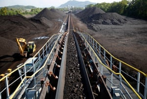 Coal is moved on a conveyor belt at the PT Bukit Asam open pit coal mine in Tanjung Enim, South Sumatera province, Indonesia