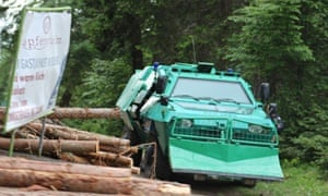 An armoured personnel carrier sits in the woods during the Bilderberg conference.