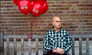 A Labour party supporter waits for Ed Milliband to address a rally in front of Hornsey Town Hall in Crouch End, North London, in the final days before the 2015 General Election.
